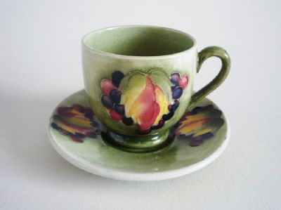 William Moorcroft 'Leaf and Berry' Coffee Cup and Saucer c1930